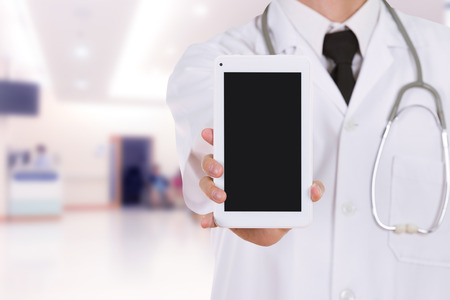 blank tablet: close-up doctor showing tablet computer blank screen in hospital Stock Photo