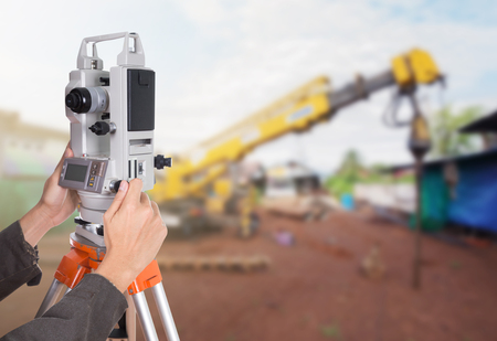 boring rig: Engineers use tacheometer or theodolite with construction site background