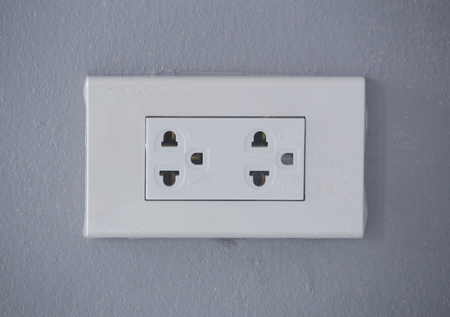 wall socket: new Electric Wall Socket with Wall Plate on gray wall background