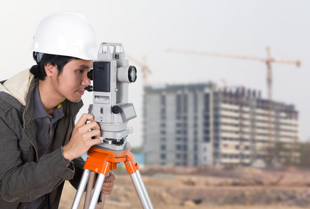 tacheometer: Engineers use tacheometer or theodolite with building construction site background