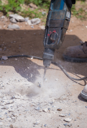 jack tar: Worker repairing and drilling the concrete road Stock Photo