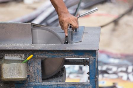 aluminium: Professional Worker cutting aluminium with grinder blade