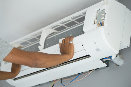 fixer: Worker installing air conditioning unit