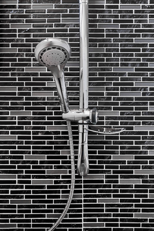 bathroom tile: Bath shower on tile wall in bathroom