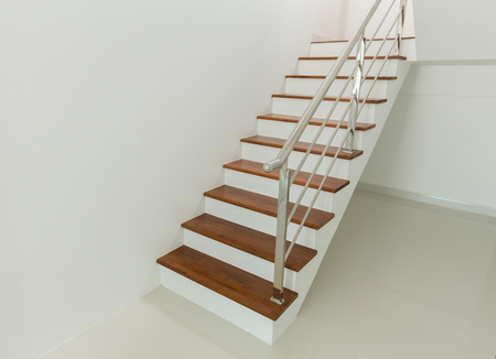 handrail: Interior - wood stairs and handrail in house