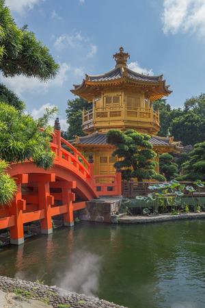 golden teak wood pagoda at Nan Lian Garden in Hong Kong, China Stock Photo