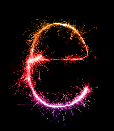 Sparkler firework light alphabet e (Small Letters) at night background Stock Photo