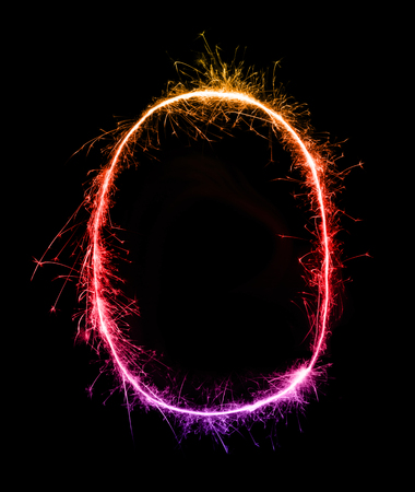 Sparkler firework light alphabet O at night background Stock Photo