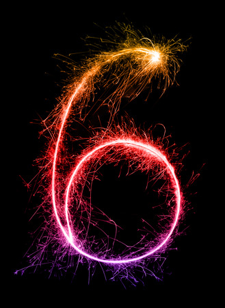6.Digit six made of firework sparklers at night background