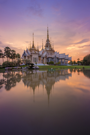 Wat Luang Pho Toh temple with water reflection in twilight time at Nakhon Ratchasima province, Thailand (The public anyone access)