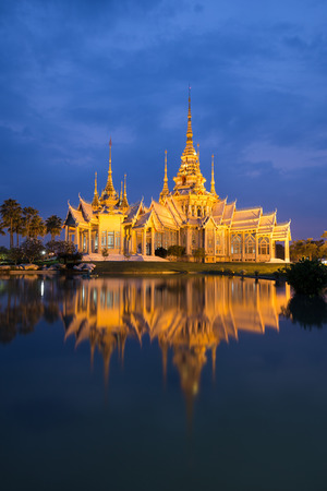 korat: Wat Luang Pho Toh temple with water reflection in twilight time at Nakhon Ratchasima province, Thailand (The public anyone access)
