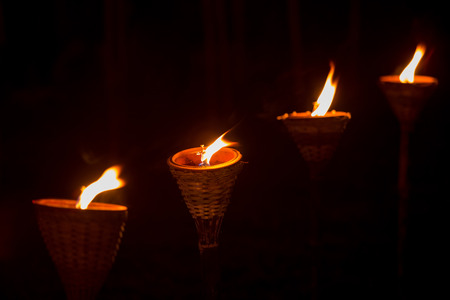 Traditional wooden torch flame at night Stock Photo