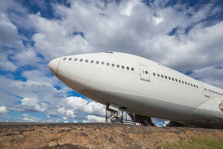 runways: Big head plane on runways with cloud and blue sky background Stock Photo