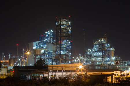 Oil refinery industrial plant at night, Thailand Stock Photo