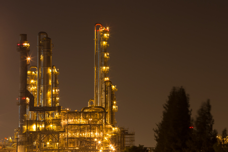 gas burner: Oil refinery industrial plant at night, Thailand Stock Photo
