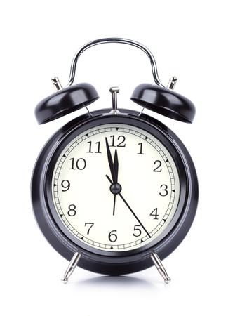 12 o clock: 12 O Clock on alarm clock isolated on white background Stock Photo