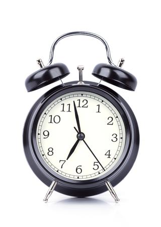 7 O Clock on alarm clock isolated on white background Stock Photo