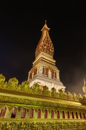 tat: Wat Phra That Phanom temple at night, Nakhon Phanom, Thailand. Stock Photo