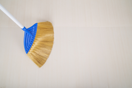 cleaning service: broom on the floor background Stock Photo