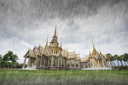 korat: Wat Luang Pho Toh temple with falling rain in Nakhon Ratchasima province, Thailand