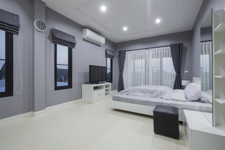Modern bedroom interior in home 免版税图像 - 77827791