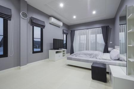 Modern bedroom interior in home Standard-Bild