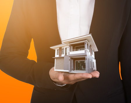 architect: house in business human hand with sunlight Stock Photo
