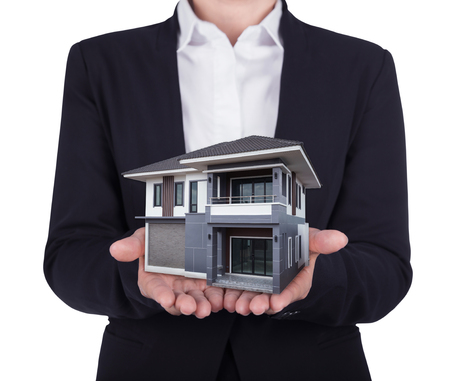 architect: house in business human hand isolated on white background