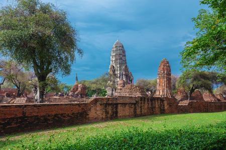 Ruins of buddha statues and pagoda of Wat Ratcha Burana temple in Ayutthaya historical park, Thailand
