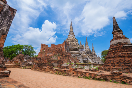 Ruins of buddha statues and pagoda of Wat Phra Si Sanphet temple in Ayutthaya historical park, Thailand Stock Photo