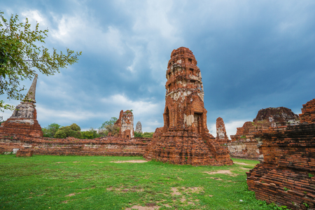 Ruins of buddha statues and pagoda of Wat Mahathat temple in Ayutthaya historical park, Thailand Stock Photo