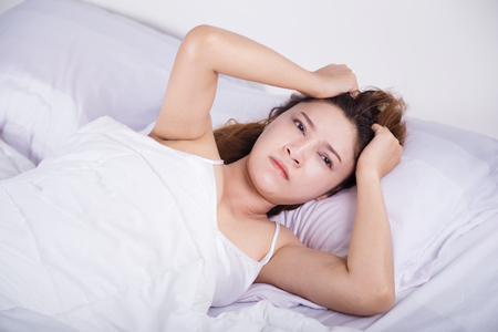 woman sleepless on bed in the bedroom