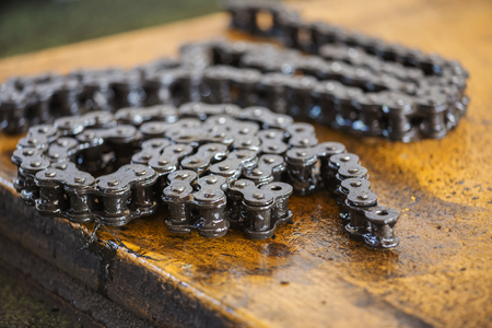 old black roller chain of machine Stock Photo