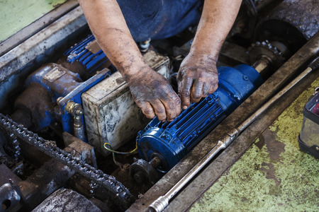 roller: hand of repairman use fabric cleaning and during maintenance work of the electric motor