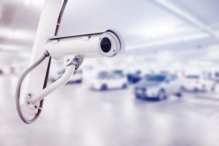 CCTV security camera with blurred car parking background Foto de archivo