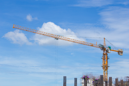 hook up: construction crane and worker of building industry with blue sky background