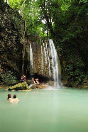 KANCHANABURI, THAILAND - JUNE 24: People traveling and bath in Erawan waterfall, Thailand on June 24, 2017 Editorial