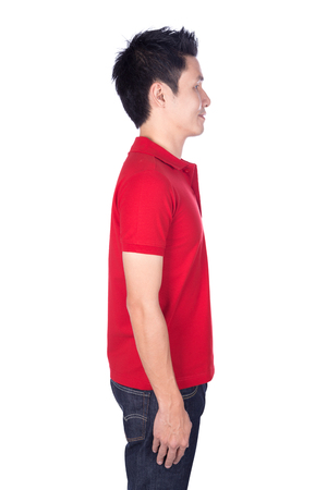 man in red polo shirt isolated on a white background (side view) 免版税图像