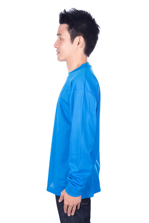 man in blue long sleeve t-shirt isolated on a white background (side view)