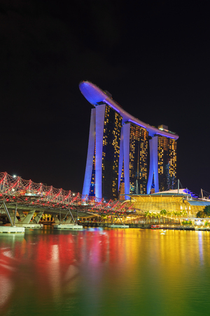 view of the Helix Bridge at night, urban landscape of Singapore