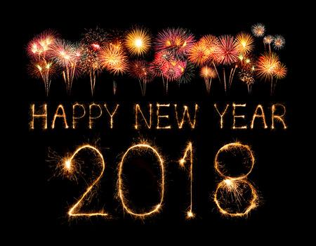 Felice anno nuovo 2018 scritto con fuoco d'artificio Sparkle durante la notte Archivio Fotografico - 86520757