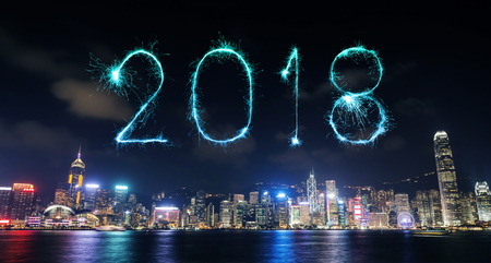 2018 Happy new year firework Sparkle with Hong Kong cityscape at night