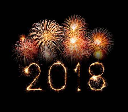 Happy new year 2018 written with Sparkle firework at night Standard-Bild