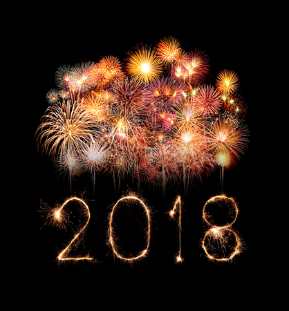 Happy new year 2018 written with Sparkle firework at night Imagens - 87099027