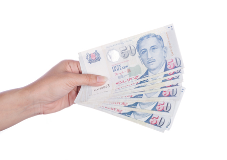 hand with Singapore banknotes dollars (50 SGD) isolated on a white background Stock Photo