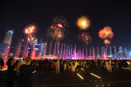 SINGAPORE - AUG 19, 2017 :  Tourists visit SPECTRA – LIGHT & WATER SHOW at Marina bay sands front in Singapore Editorial