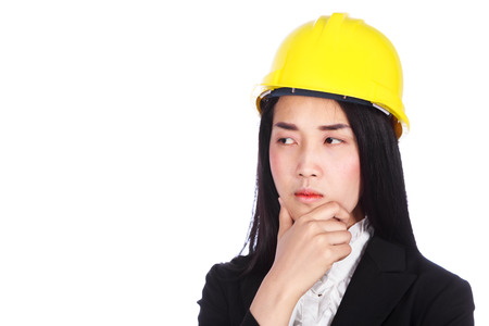 Young business woman engineer thinking isolated on white background
