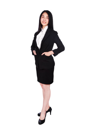 young business woman smiling in suit standing relaxing and hand in pocket isolated on white background