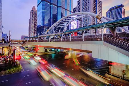 BANGKOK, THAILAND – November 18, 2017: public sky walk and traffic at Chong Nonsi sky train station at night, Bangkok, Thailand Editorial
