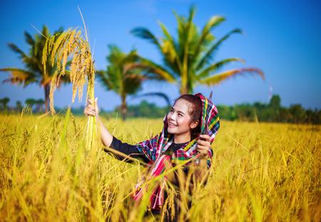happy farmer woman in rice field, Thailand